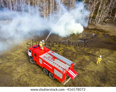 Fighting the forest fire - stock photo