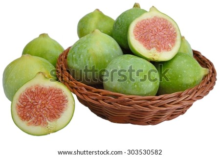 figs in a wicker basket on White background - stock photo