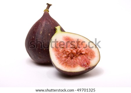 Figs one halved isolated against white background. - stock photo