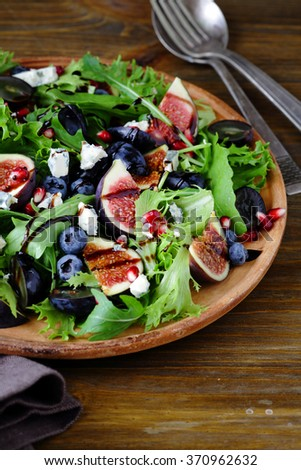 figs salad with cheese on plate - stock photo