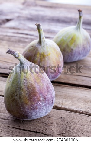 Figs whole shot on wood front on portrait - stock photo