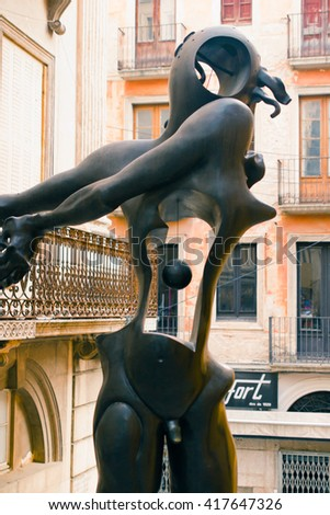 FIGUERES, SPAIN - OCTOBER 23, 2013: Sculpture on the design of Salvador Dali at the Square Gala-Salvador Dalí in Figueres near the Theater-Museum Dalí S?lvador on October 23, 2013. - stock photo