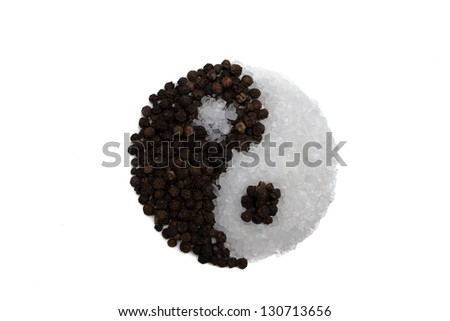 Figure in the form of the yin-yang of pepper and salt - stock photo