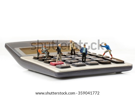 figure model standing and talking on calculator,business connection concept,selective focus - stock photo