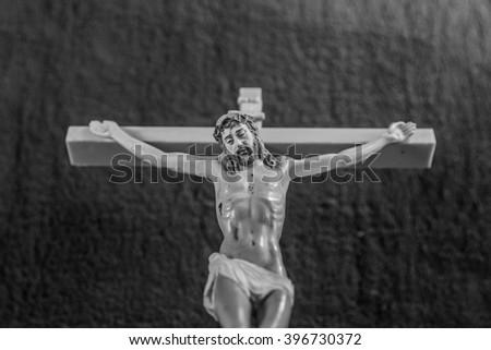 figure of jesus on the cross - stock photo