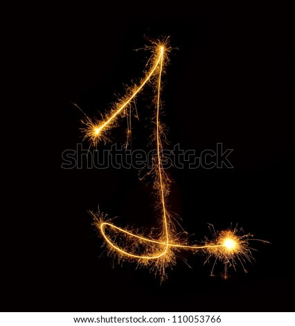Figure one.abstract sparkler figures on black background. - stock photo