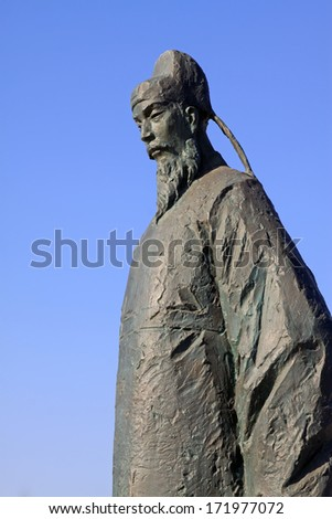 Figure sculpture in the blue sky in a park, north china