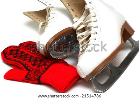 Figure skates and mittens - stock photo