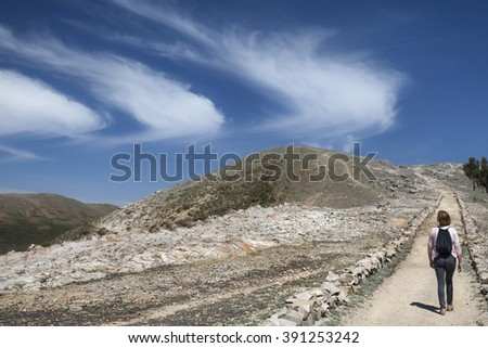 Figure walking on Islas del Sol on Lake Titicaca, Bolivia, South America - stock photo