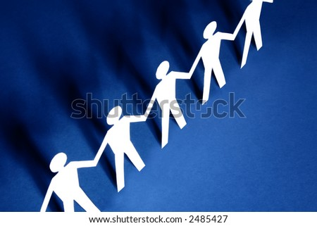 figures holding hands together - stock photo