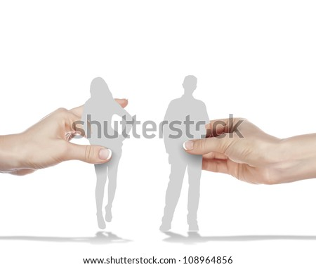 Figures of man and woman standing next to each other - stock photo