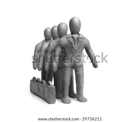 Figures of  plasticine businessmen on a white background - stock photo