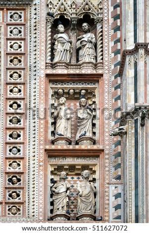 Figures sacred in niches. Site of a facade of the Cathedral, Orviyeto, Italy.