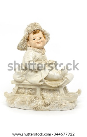 figurine a boy on a sled isolated on white