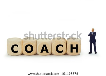 Figurine from Businessman with wooden cubes on white background - stock photo