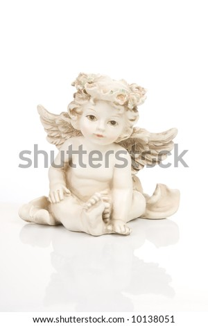 Figurine little white angel, front side - stock photo