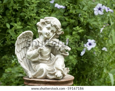 Figurine of an angel playing the violin - stock photo