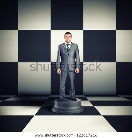 Figurine of businessman in chess room - stock photo