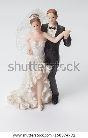 figurine on a wedding cake isolated - stock photo