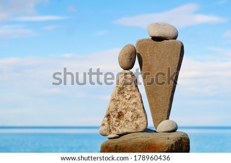 Figurines of stones as symbol of man and woman - stock photo