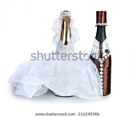 figurines of the bride and groom.champagne.Souvenir bottles for a wedding on a white background