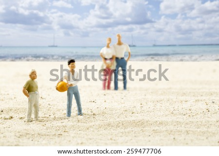 Figurines on beach, holiday