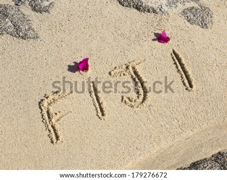 fiji written on a wet beach - stock photo