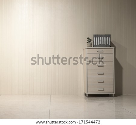 File cabinet and folders, in the clean office - stock photo