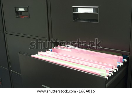 File cabinet with a drawer opened - stock photo