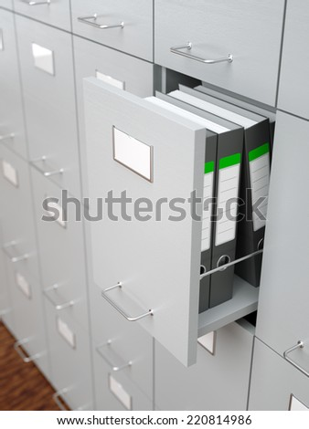 File cabinet with half-open drawer - stock photo