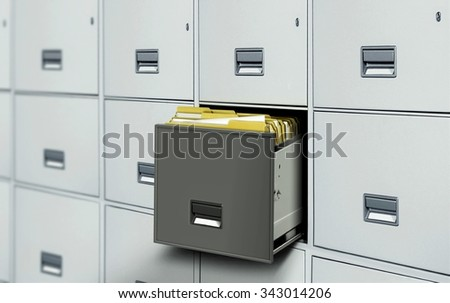 File cabinet with open drawer and files - stock photo