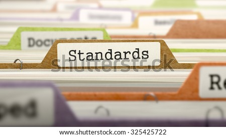 File Folder Labeled as Standards in Multicolor Archive. Closeup View. Blurred Image.
