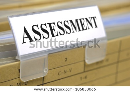 file folder marked with assessment - stock photo