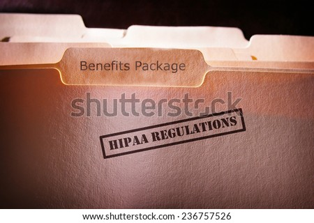 file folders with HIPAA text and Benefits Package text - stock photo