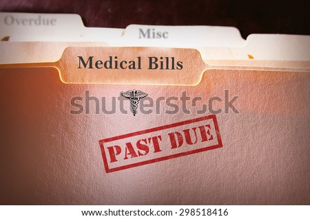 File folders with Past Due Medical Bills text - stock photo