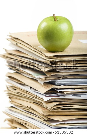 File Stack and green apple close up shot on white  background - stock photo