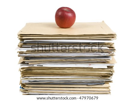 File Stack and red apple close up shot on white background - stock photo
