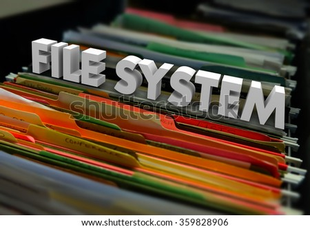 File System words in 3d letters on folders in a cabinet to illustrate historical archived documents organized - stock photo