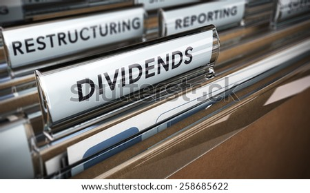 File tab with focus on the word dividends. Conceptual image for illustration of company restructuring plan and dividend. - stock photo