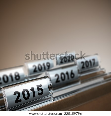 File tab with focus on 2015 year, beige background. Image concept for illustration of mid-term or long-term business strategy. - stock photo