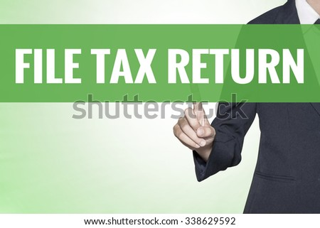 File Tax Return word on green virtual screen touching by business woman - stock photo