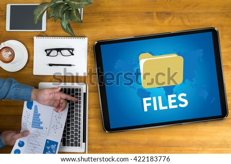 FILES Businessman working at office desk and using computer and objects, coffee, top view, - stock photo