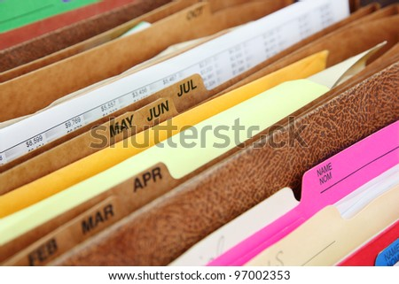 Files. Closeup of folders in expending file pockets - stock photo