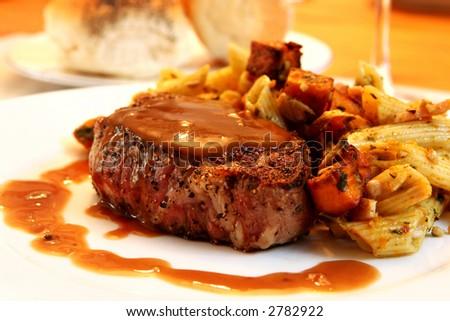 Filet Mignon beef steak with pasta vegetable salad. - stock photo