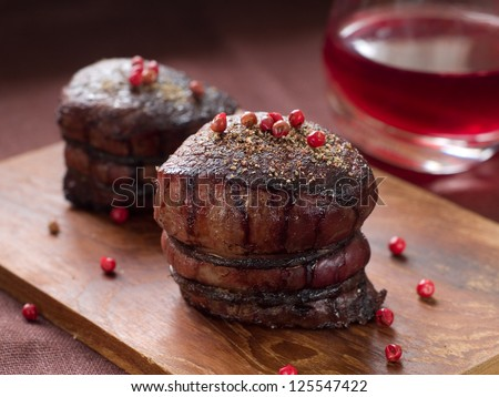 Filet mignon with red pepper and wine sauce, selective focus - stock photo