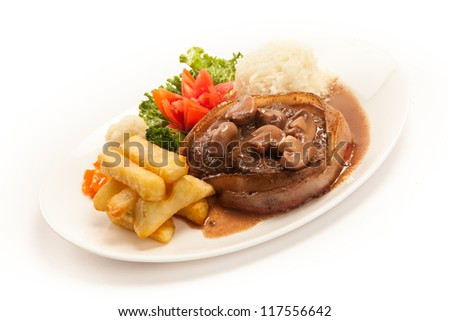 Filet Mignon with rice and french fries - stock photo