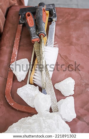 Filing and sawing ice manufacturing and industry - stock photo
