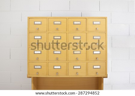 Filing cabinet wood- front view - stock photo