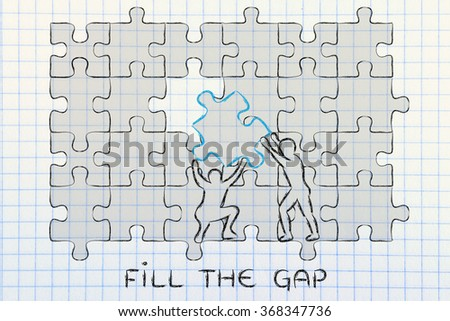 fill the gap: men completing a jigsaw puzzle with the missing piece