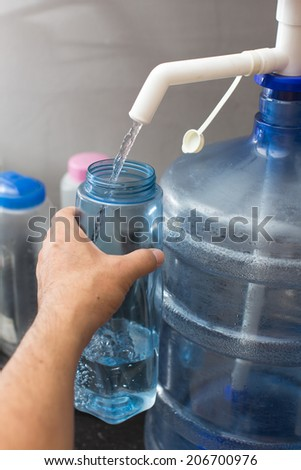 fill water into bottle - stock photo